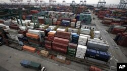 In this file photo, hundreds of shipping containers in Shanghai filled with products wait to be exported to the United States and other countries.