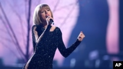 FILE - Taylor Swift performs at the 58th annual Grammy Awards in Los Angeles, Feb. 15, 2016.