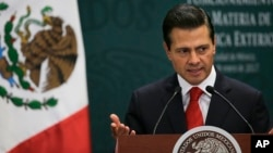 Mexico's President Enrique Pena Nieto speaks during a press conference at Los Pinos presidential residence in Mexico City, Jan. 23, 2017.