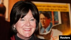 """FILE - Actress Mary Badham, who portrayed the character """"Scout,"""" poses at a screening celebrating the 50th anniversary of the Academy Award-winning film """"To Kill A Mockingbird"""" at the Academy of Motion Picture Arts & Sciences in Beverly Hills, California, April"""
