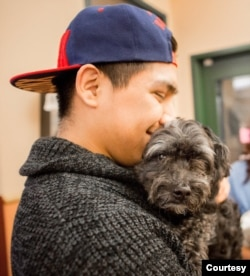 This man is being reunited with his lost dog that was brought to the Dane County Humane Society in Madison, Wisconsin. (Dane County Humane Society)