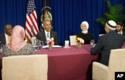 FILE - President Barack Obama meets with members of Muslim-American community at the Islamic Society of Baltimore, Feb. 3, 2016.