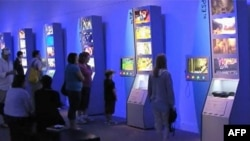 "Visitors interact with the new exhibit, ""The Art of Video Games,"" Smithsonian's National Museum of American Art."