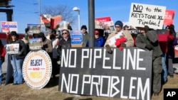 Demonstrators opposing the Keystone XL oil pipeline hold banners in Omaha, Neb., Jan. 13, 2015. Democrats hope to use Senate consideration of the oil pipeline to get Republicans on the record about climate change and resurrect parts of a bipartisan energy