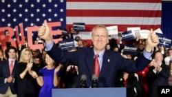 Republican gubernatorial candidate Bruce Rauner of Illinois celebrates his win over Democratic Gov. Pat Quinn, in Chicago, Nov. 4, 2014.