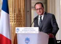 FILE - French President Francois Hollande annoucned his country will send reconnaissance planes over Syria in the fight against the Islamic State group, at the Elysee Palace in Paris, France, Sept. 7, 2015.