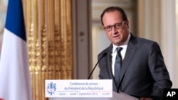 French President Francois Hollande speaks during his press conference at the Elysee Palace in Paris, France, Sept. 7, 2015.