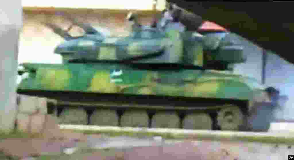 This image from amateur video purports to show a Syrian military tank in Daraa, February 16, 2012. (AP / Shaam)