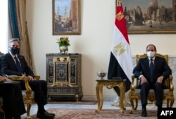 U.S. Secretary of State Antony Blinken, left, meets with Egypt's President Abdel-Fattah el-Sissi at the Heliopolis Presidential Palace on May 26, 2021.