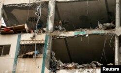 Gazze'de İsrail hava saldırısı sonucu hasar gören bir bina