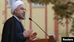 In this photo released by the official website of the office of the Iranian Presidency, Iran's President Hassan Rouhani speaks during a news briefing at the Presidency compound in Tehran, Nov. 24, 2013.