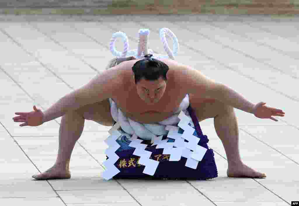 """Yokozuna"" or sumo grand champion Hakuho of Mongolia takes part in a traditional ring-entering ceremony at Meiji shrine in Tokyo, Japan."