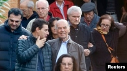 FILE - Convicted former Nazi SS officer Erich Priebke (C) and his lawyer, Paolo Giachini (L), are seen exiting a church after a mass in northern Rome October 17, 2010.