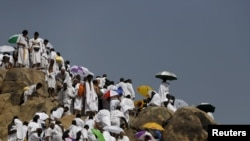 Muslim pilgrims visit Mount Mercy on the plains of Arafat during the annual haj pilgrimage, outside the holy city of Mecca, Sept. 23, 2015.