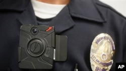FILE - Police officer demonstrates on-body camera for media in Los Angeles, California.