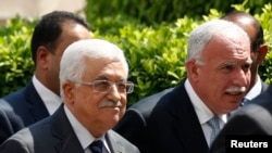 Palestinian President Mahmoud Abbas and his foreign minister Riyad al-Maliki, right, arrive for an Arab League Foreign Ministers emergency meeting, Cairo, Sept. 7, 2014.