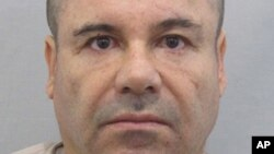"""FILE - Drug lord Joaquin """"El Chapo"""" Guzman before he escaped from the Altiplano maximum security prison in Almoloya, west of Mexico City, July 12, 2015."""