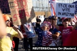 USA, Phoenix, Maricopa, Supporters of U.S. President Donald Trump react to a speaker during a protest