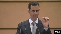 Presiden Suriah Bashar al-Assad berpidato di Universitas Damaskus (10/1).