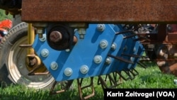 """A tractor with a farming """"implement"""" attached. South Sudan President Salva Kiir bought 1,000 tractors for the country's farmers, but they have not yet been delivered."""