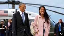 President Barack Obama jokes with his daughter Malia Obama as they walk to board Air Force One from the Marine One helicopter, April 7, 2016, as they leave Chicago en route to Los Angeles.