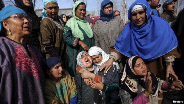 Kashmiri Muslim women wail during the funeral of Ashiq Hussain, a suspected militant, in Charsoo village in south Kashmir, March 3, 2016.