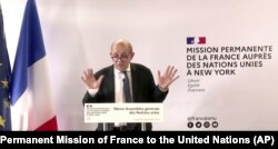 In this photo taken from video, France's Foreign Minister Jean-Yves Le Drian speaks during a news conference, Sept. 20, 2021, in New York.