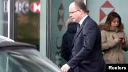 Генеральный прокурор Женевы Оливье Жорно покидает швейцарский офис банка HSBC. Женева, Швейцария. 18 февраля 2015 г.