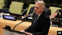 FILE - French Foreign Minister Jean-Marc Ayrault speaks during a meeting addressing actions and cooperation on the large movement of refugees and migrants, Sept. 19, 2016, at U.N. headquarters.