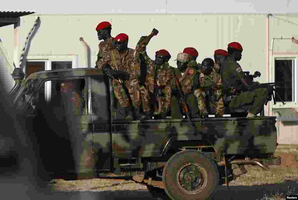 SPLA soldiers sit on a military vehicle in Juba, South Sudan, Dec. 20, 2013.