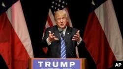 美国共和党总统候选人2016年6月16日在达拉斯的一次集会上讲话。