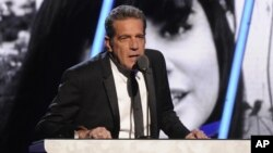 FILE - Glenn Frey of the Eagles speaks at the 2014 Rock and Roll Hall of Fame Induction Ceremony in New York, April, 10, 2014.