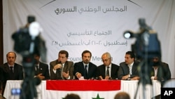 Syrian opposition members (L to R) Ahmed Ramadan, Khaled Hassaleh, Hassan Hashmi, Lovay Safi, Abdul Basit Sida, Adip Shishakil and Hassan Shalabi attend a news conference after their meeting in Istanbul, August 23, 2011