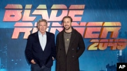Actors Harrison Ford, left, and Ryan Gosling pose for photographers during the photo call for 'Blade Runner 2049' in London, Sept. 21, 2017.