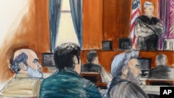 In this courtroom sketch, Sulaiman Abu Ghaith, left, listens as U.S. District Judge Lewis A. Kaplan stands to speak, March 3, 2014, during jury selection at the start of Abu Ghaith's trial in New York.