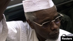 Former Chad President Hissene Habre talks to reporters as he leaves a court in Dakar, Senegal on November 25, 2005.