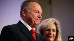Former Alabama Chief Justice and U.S. Senate candidate Roy Moore speaks at a news conference with his wife Kayla Moore, in Birmingham, Alabama, Nov. 16, 2017.