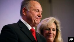 Former Alabama Chief Justice and U.S. Senate candidate Roy Moore speaks at a news conference with his wife Kayla Moore, in Birmingham, Alabama., Nov. 16, 2017.
