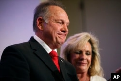 FILE - Former Alabama Chief Justice and U.S. Senate candidate Roy Moore speaks at a news conference with his wife Kayla Moore, in Birmingham, Ala., Nov. 16, 2017.