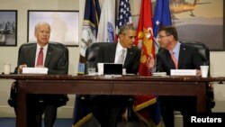 U.S. President Barack Obama chairs a National Security Council meeting on the counter-Islamic State campaign, accompanied by U.S. Vice President Joe Biden (L) and U.S. Defense Secretary Ash Carter (R) at the Pentagon in Washington Dec. 14, 2015.