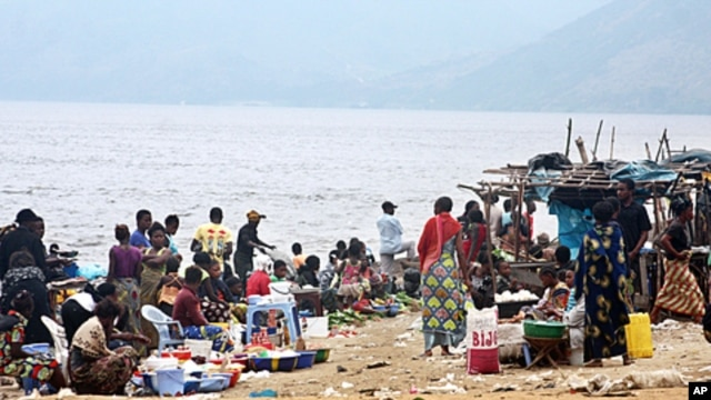 People gather at a market on July 21, 2011 on the banks of the Congo River near the village of Ngamanzo in the municipality of Maluku, Kinshasa province, an area under surveillance by medical officials for signs of cholera.
