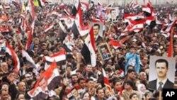 支持總統阿薩德的示威者星期三在大馬士革舉行集會