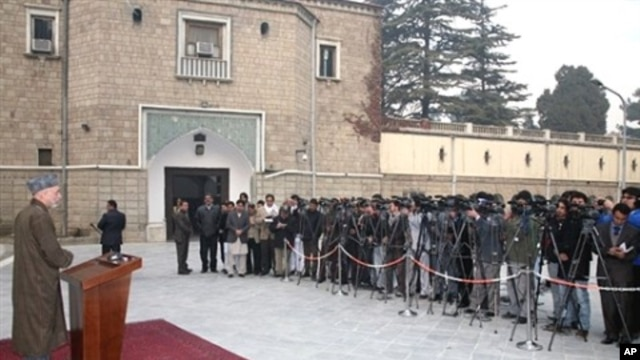 In this handout photograph provided by the Afghan Presidential Palace, President Hamid Karzai gives a press conference on Eid al-Adha in Kabul, 27 Nov 2009