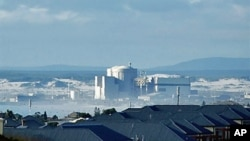 FILE - Koeberg Nuclear Power Station, about 30 kilometers north of Cape Town, is owned and operated by South Africa's power utility Eksom.