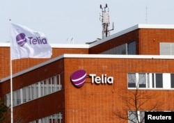 FILE - A flag flutters at the Telia telecommunication company headquarters in Helsinki, Finland, May 5, 2017.