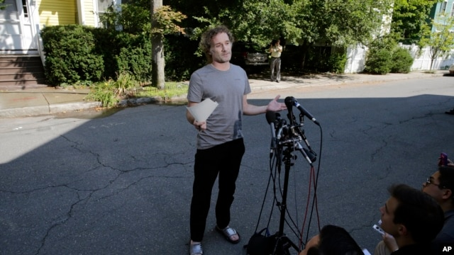 Peter Theo Curtis reads a statement to reporters outside his mother's home in Cambridge, Mass., Aug. 27, 2014.
