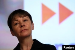 """FILE - Green Party MP Caroline Lucas speaks at a """"Vote In - Another Europe is Possible """" rally in London, May 28, 2016."""