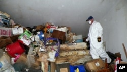 Items from a hoarder's home in Las Vegas in 2012 are stacked from floor to ceiling inside.