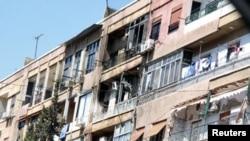 Des maisons endommagées durant les affrontements de lundi à Damas