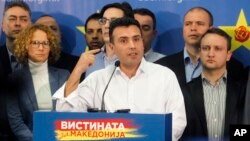FILE - Zoran Zaev, the leader of the opposition Social-Democratic Alliance of Macedonia, gestures while speaking at a news conference at the party headquarters in Skopje, Macedonia, March 2, 2015.